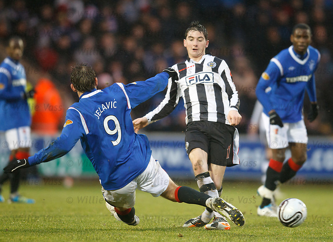 Nikica Jelavic flies into Kenny McLean