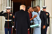 United States President Barack Obama (R) and Michelle Obama greet President-elect Donald Trump and wife Melania at the White House for tea before the inauguration on January 20, 2017 in Washington, D.C.  Trump becomes the 45th President of the United States.    <br /> Credit: Kevin Dietsch / Pool via CNP
