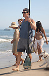 8-30-09   Monday ..Malibu California Matthew McConaughey playing on the beach with Camila Alves & baby Levi.  Matt was holding a canoo paddle wearing a blue tank top while Camila was showing of her huge pregnant baby bump belly wearing a white lace shawl. Camila didn't try to cover up her upper body sporting a brown striped bikini top. Baby Levi was wearing a blue wetsuit with a  cute little turtle on it.  ....www.AbilityFilms.com.805-427-3519.AbilityFilms@yahoo.com