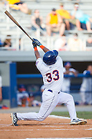 Hengelbert Rojas (33) of the Kingsport Mets follows through on his swing against the Elizabethton Twins at Hunter Wright Stadium on July 9, 2015 in Kingsport, Tennessee.  The Twins defeated the Mets 9-7 in 11 innings. (Brian Westerholt/Four Seam Images)
