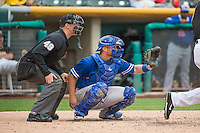 Brian Ward (10) of the Oklahoma City Dodgers  and home plate umpire Travis Eggert behind the plate in action against the Salt Lake Bees in Pacific Coast League action at Smith's Ballpark on May 25, 2015 in Salt Lake City, Utah.  (Stephen Smith/Four Seam Images)