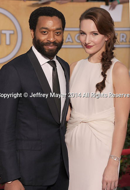 LOS ANGELES, CA- JANUARY 18: Actor Chiwetel Ejiofor and Sari Mercer arrive at the 20th Annual Screen Actors Guild Awards at The Shrine Auditorium on January 18, 2014 in Los Angeles, California.