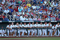 The Virginia Cavaliers dugout looks on during Game 4 of the 2014 Men's College World Series between the Virginia Cavaliers and Ole Miss Rebels at TD Ameritrade Park on June 15, 2014 in Omaha, Nebraska. (Brace Hemmelgarn/Four Seam Images)