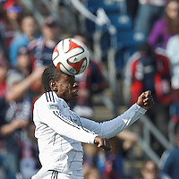 New England Revolution midfielder Kelyn Rowe (11) heads the ball. In a Major League Soccer (MLS) match, the New England Revolution (blue/white) tied Vancouver Whitecaps FC (white), 0-0, at Gillette Stadium on March 22, 2014.