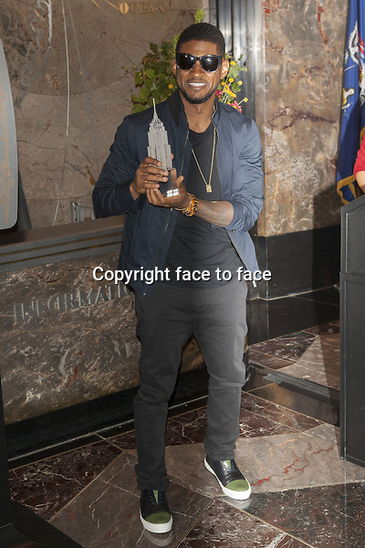 NEW YORK, NY - JULY 3: Grammy Award-Winning Superstar Usher Lights the World-Famous Empire State Building in Celebration of Independence Day on July 3, 2013 in New York City.<br />