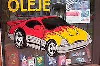 Painted hot rod on window of car shop on Poland.  Rawa Mazowiecka  Central Poland