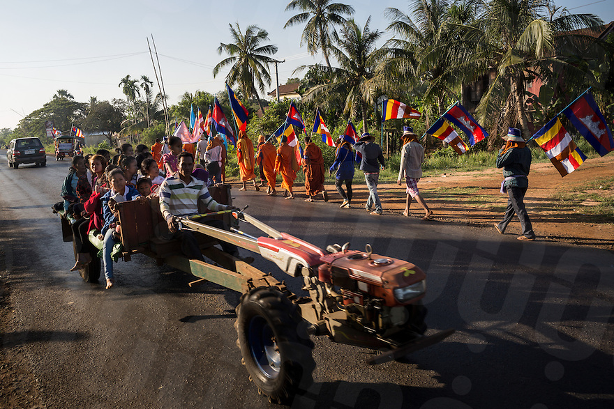 December 04, 2013 - Kampong Thom, Cambodia. Monks and activists on the road during a 10 day Human Rights march through the country. © Nicolas Axelrod / Ruom