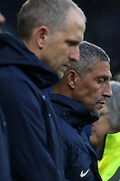 Former Cardiff City Manager, now Brighton and Hove Albion Assistant Manager Paul Trollope with Brighton and Hove Albion Manager Chris Hughton observe a minutes silence prior to kick off of the Sky Bet Championship match between Cardiff City and Brighton and Hove Albion at The Cardiff City Stadium, Wales, UK. Saturday 04 December 2016