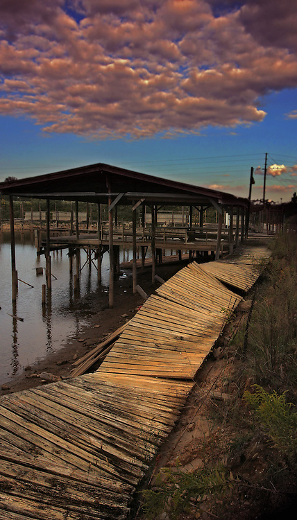 A damaged boat dock and walkway during a drought.