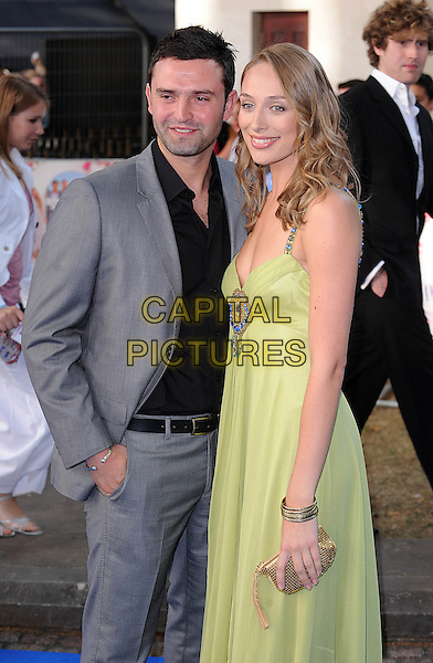 "RACHEL McDOWELL & GUEST .Attending the World Premiere of ""Mamma Mia!"" Odeon Leicester Square, London, England, 30th June 2008..arrivals half length grey gray suit green dress  black shirt .CAP/BEL.©Tom Belcher/Capital Pictures"