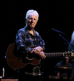 A portrait of Graham Nash.  David Crosby and  Graham Nash  at the Neal S. Blaisdell Center in Honolulu, HI, with James Raymond on keyboards and Shane Fontayne on lead guitar.