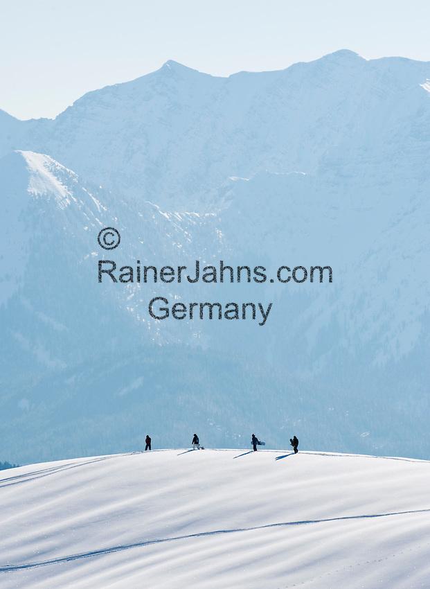 Germany, Bavaria, Upper Bavaria, Tegernseer Valley, at Wallberg mountain, 4 snowboarder looking for remote ski-runs