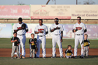 Juremi Profar (7), Josh Morgan (3), Travis Demeritte (2), Tripp Martin (10) of the High Desert Mavericks stand in the infield with four young little leaguers during the playing of the national anthem before a game against the Modesto Nuts at Heritage Field on June 3, 2016 in Adelanto, California. Modesto defeated High Desert, 2-1. (Larry Goren/Four Seam Images)
