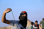 Palestinian protesters clash with Israeli troops following the tents protest where Palestinians demand the right to return to their homeland at the Israel-Gaza border, in Khan Younis in the southern Gaza Strip, August 02, 2019. Photo by Mariam Dagga