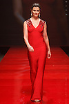 walks runway in a red dress by Herve Leger by Max Azria, for the Red Dress Collection 2017 fashion show, for The American Heart Association, presented by Macy's at the Hammerstein Ballroom in New York City on February 9, 2017; during New York Fashion Week Fall 2017.