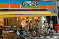 "Customers at a 99 Yen shop in Tokyo, Japan. The 99 Yen shop, along with similar shops such as the ""100 Yen shop"" have been runaway successes in Japan and undergone rapid expension in the past years. The shops sell a wide variety of products for 100 yen (0.7 euros).."