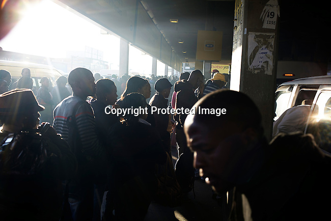 SOWETO, SOUTH AFRICA MAY 2: A view of the morning rush hour on May 2, 2013 at Bara taxi station in Soweto, South Africa. This is Soweto's main taxi station and tens of thousands of people use it every day to commute to work in Johannesburg. The township is a mix of old housing and newly constructed townhouses. A new hungry black middle-class is growing steadily. Many residents work in Johannesburg but the last years many shopping malls have been built, and people are starting to spend their money in Soweto. (Photo by: Per-Anders Pettersson)