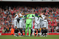 Pictured: Swansea players huddle before the start of the game. Saturday 10 September 2011<br />