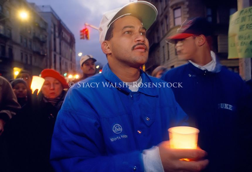 Fernando Mateo, founder of Toys for Guns, leads a candlelight march through the neighborhood of Manhattan Valley, against guns and drugs.
