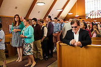 "People wait to receive communion at St. Frances Xavier Cabrini Church in Scituate, Mass., on Sun., May 29, 2016. Members of the congregation have been holding a vigil for more than 11 years after the Archdiocese of Boston ordered the parish closed in 2004. For 4234 days, at least one member of Friends of St. Frances X. Cabrini has been at the church at all times, preventing the closure of the church. May 29, 2016, was the last service held at the church after members finally agreed to leave the building after the US Supreme Court decided not to hear their appeal to earlier an Massachusetts court ruling stating that they must leave. The last service was called a ""transitional mass"" and was the first sanctioned mass performed at the church since the vigil began."