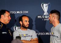 CARSON, CA - NOVEMBER 30, 2012: Coach Bruce Arena of the Los Angeles Galaxy with  Landon Donovan (10) and  Robbie Keane (7) during a press conference at Home Depot Center, in Carson, CA, before the 2012 MLS Cup, on November 30, 2012.