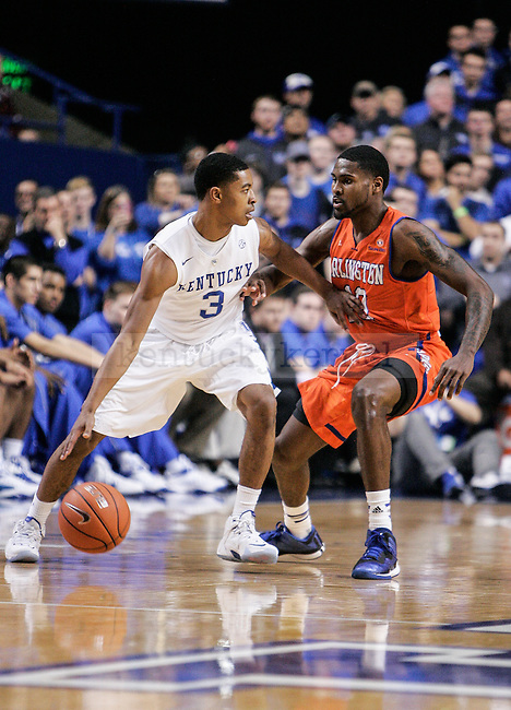 Kentucky guard Tyler Ulis defends the ball against Arlington guard Johnny Hill during the second half of the UK vs. UT-Arlington game at Rupp Arena on Tuesday, November 25, 2014 in Lexington, Ky. UK defeated UT-Arlington 92-44. Photo by Adam Pennavaria | Staff