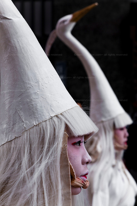 Women perform a traditional white heron dance, (shira sagi no mai) during the Sanja matsuri in  Asakusa, Tokyo, Japan. Friday may 16th 2014