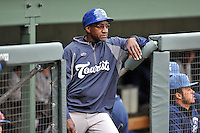 Coach Mike Devereaux (12) of the Asheville Tourists in a game against the Greenville Drive on Thursday, April 7, 2016, at Fluor Field at the West End in Greenville, South Carolina. Greenville won, 4-3. (Tom Priddy/Four Seam Images)