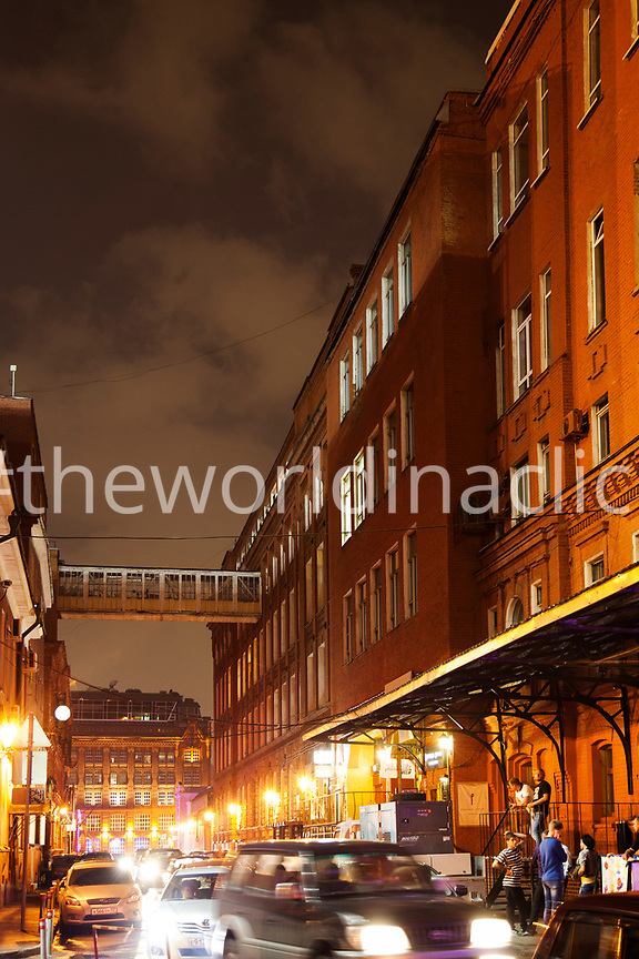 RUSSIA, Moscow. Night scene at Red October, a former chocolate factory that has reopened new bars and restaurants.