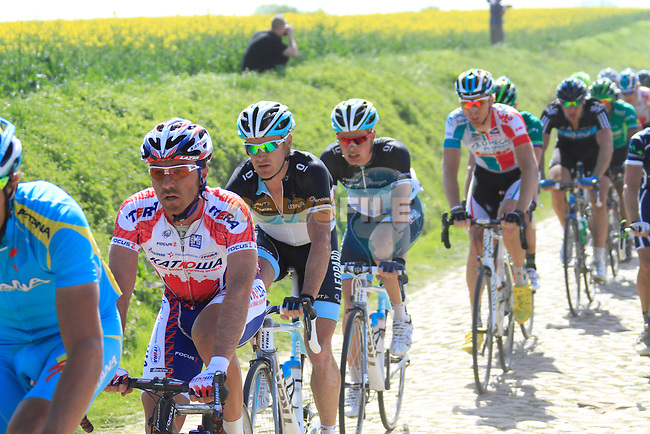 The main bunch passes over Pave Section 23, pave de Vertain a Saint-Martin-sur-Ecaillon, during the 109th edition of the Paris-Roubaix cycle race, 10th April 2011 (Photo by Eoin Clarke/NEWSFILE)