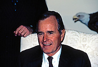 ***FILE PHOTO*** George H.W. Bush Has Passed Away<br /> Washington, DC., USA, Janaury 22, 1985<br /> Vice-President George H.W. Bush is seated in armchair in the Oval Office of the White House. <br /> CAP/MPI/MRN<br /> &copy;MRN/MPI/Capital Pictures