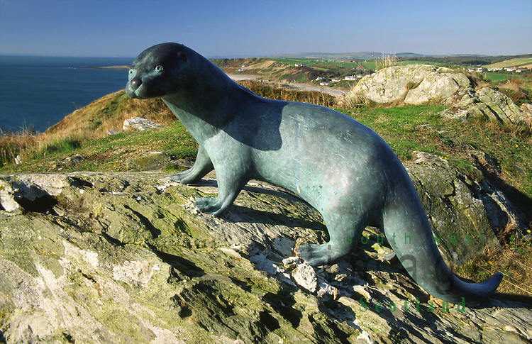 Monument to the author Gavin Maxwell of a otter at Monreith over looking Luce Bay in the Machars of Galloway Scotland UK