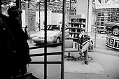 Moscow, Russia<br /> Soviet Union<br /> August 1991<br /> <br /> A new Ford, American car dealership on Tverskaya, the main street in Moscow.<br /> <br /> In December 1991, food shortages in central Russia had prompted food rationing in the Moscow area for the first time since World War II. Amid steady collapse, Soviet President Gorbachev and his government continued to oppose rapid market reforms like Yavlinsky's &quot;500 Days&quot; program. To break Gorbachev's opposition, Yeltsin decided to disband the USSR in accordance with the Treaty of the Union of 1922 and thereby remove Gorbachev and the Soviet government from power. The step was also enthusiastically supported by the governments of Ukraine and Belarus, which were parties of the Treaty of 1922 along with Russia.<br /> <br /> On December 21, 1991, representatives of all member republics except Georgia signed the Alma-Ata Protocol, in which they confirmed the dissolution of the Union. That same day, all former-Soviet republics agreed to join the CIS, with the exception of the three Baltic States.