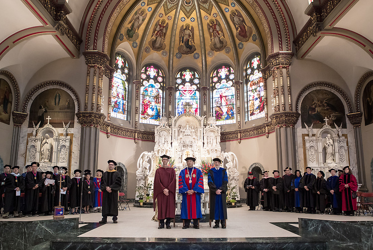 Left to right, Jeff Bethke, executive vice president, A. Gabriel Esteban, Ph.D., president of DePaul University, and Marten denBoer, provost, stand as faculty and staff enter into the St. Vincent de Paul Parish Church for the annual Academic Convocation ceremony, Thursday, Aug. 31, 2017, on the Lincoln Park Campus. (DePaul University/Jeff Carrion)