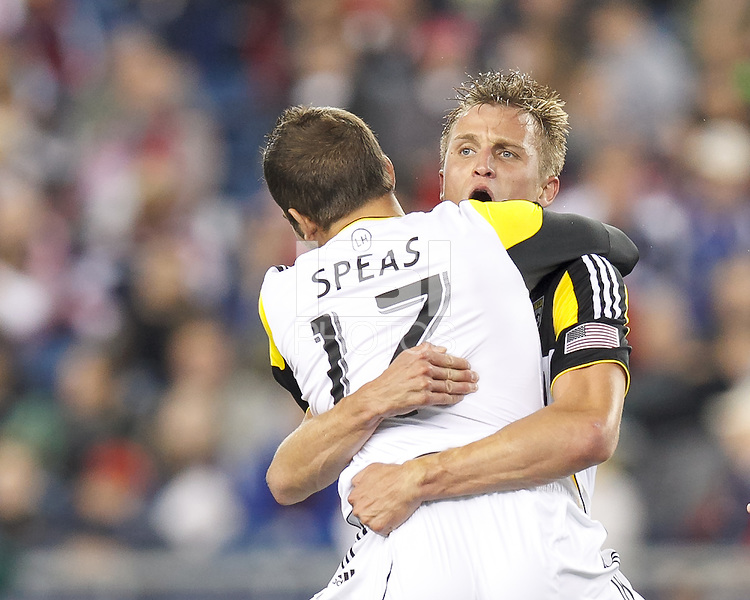 Columbus Crew substitute forward Aaron Schoenfeld (18) celebrates his goal with teammate. In a Major League Soccer (MLS) match, the New England Revolution (blue) defeated Columbus Crew (white), 3-2, at Gillette Stadium on October 19, 2013.