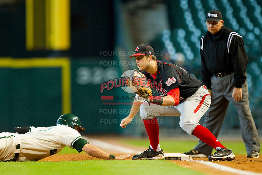 First baseman C.J. Cron #24 of the Utah Utes waits for a pick off throw as a Baylor Bear runner dives back to the bag at Minute Maid Park on March 5, 2011 in Houston, Texas.  Photo by Brian Westerholt / Four Seam Images
