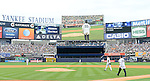 Hideki Matsui,<br /> JULY 28, 2013 - MLB :<br /> Hideki Matsui walks to the mound to throw out the ceremonial first pitch as New York Yankees starting pitcher Phil Hughes looks on during Matsui's official retirement ceremony before the Major League Baseball game against the Tampa Bay Rays at Yankee Stadium in The Bronx, New York, United States. (Photo by AFLO)