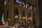 Mass taking place inside the cathedral of Notre Dame de Paris, France.