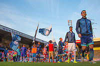 The Teams head onto the field during the Sky Bet League 2 match between Wycombe Wanderers and Accrington Stanley at Adams Park, High Wycombe, England on 16 August 2016. Photo by Andy Rowland.