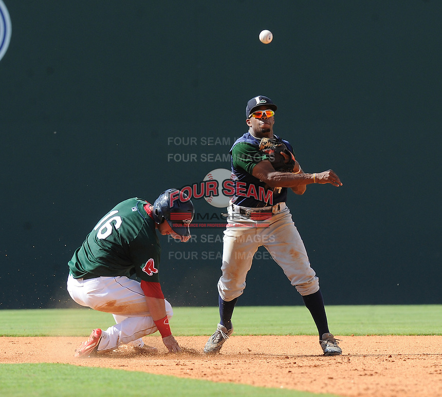 Infielder Delino DeShields, Jr. (4) of the Lexington Legends puts out David Renfroe (16) of the Greenville Drive and turns a double play in a game on July 22, 2012, at Fluor Field at the West End in Greenville, South Carolina. DeShields Jr. is the No. 8 prospect for the Astros, according to Baseball America. (Tom Priddy/Four Seam Images)