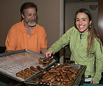 Charles Teran and Kristen Pepin serve breakfast during Snowfest at North Lake Tahoe on Saturday, March 11, 2017.