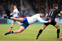 Matt Banahan of Bath Rugby tackles Chris Wyles of Saracens. Aviva Premiership match, between Saracens and Bath Rugby on April 15, 2018 at Allianz Park in London, England. Photo by: Patrick Khachfe / Onside Images