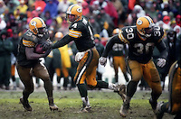 "Brett Favre hands off to Edgar Bennett during the NFC Divisional Playoff Game against the 49ers on January 4, 1997. Dubbed the ""Mud Bowl"", the Packers emerged the victor 35-14."