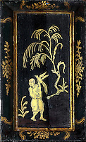 Detail of a painted Chinese motif on the bookcases with lacquer and gilding by Manuel da Silva, in the Black Room of the Joanina Library, or Biblioteca Joanina, a Baroque library built 1717-28 by Gaspar Ferreira, part of the University of Coimbra General Library, in Coimbra, Portugal. The Casa da Livraria was built during the reign of King John V or Joao V, and consists of the Green Room, Red Room and Black Room, with 250,000 books dating from the 16th - 18th centuries. The library is part of the Faculty of Law and the University is housed in the buildings of the Royal Palace of Coimbra. The building is classified as a national monument and UNESCO World Heritage Site. Picture by Manuel Cohen