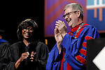 Paulette Brown, honorary degree recipient and commencement speaker, left, and the Rev. Dennis H. Holtschneider, C.M., president of DePaul share a laugh at the DePaul University College of Law commencement ceremony, Sunday, May 14, 2017. The ceremony was held at the Rosemont Theatre in Rosemont, IL, where some 240 students received their Juris Doctors or Master of Laws degrees. (DePaul University/Jeff Carrion)