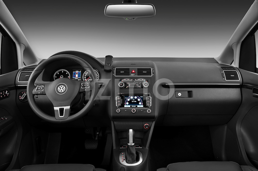 Straight dashboard view of a 2010 Volkswagen Touran Highline 5 Door Mini MPV.