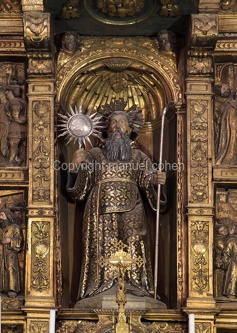 Statue of St Francois de Paule holding the sun and the staff of the founder, from the altarpiece of the St Francois de Paule Chapel, begun 1656 by LLatzer Tremullas and completed 1657 by LLuis Generes, gilded and painted 1666 by Gilles Bedanson, and installed here in 1791, Perpignan Cathedral, Perpignan, Pyrenees-Orientales, France. The reliefs show scenes from the life of the saint. The Cathedral Basilica of Saint John the Baptist of Perpignan, or Basilique-Cathedrale de Saint-Jean-Baptiste de Perpignan was begun in 1324 by King Sancho of Majorca in Catalan Gothic style, and later finished in the 15th century. The cathedral is listed as a national monument of France. Picture by Manuel Cohen