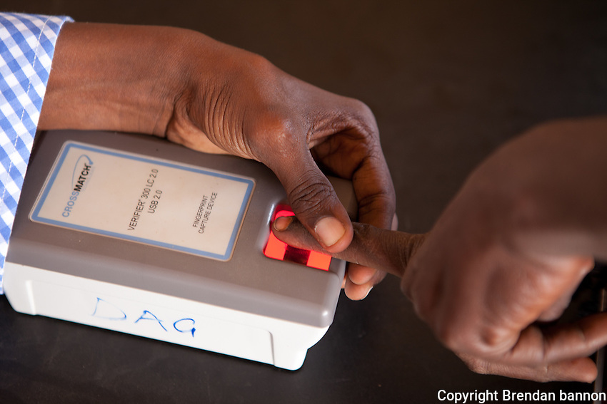 A Somali refugee is finger printed upon arrival at dagahaley camp, part of the sprawling refugee camp complex in Dadaab, Kenya. all refugees are fingerprinted as part of the registration process. October 2011.