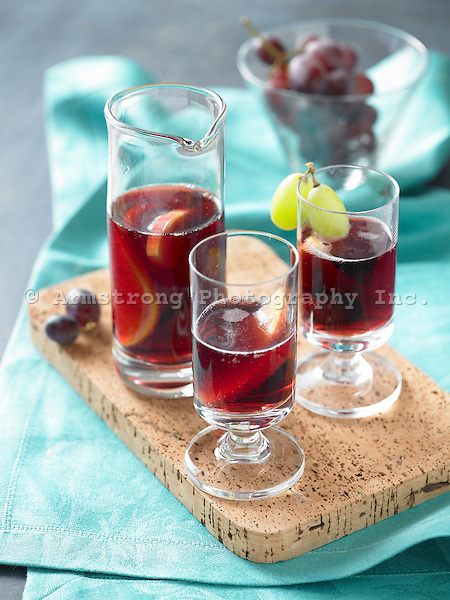 Glasses of sangria with grapes and orange slices.