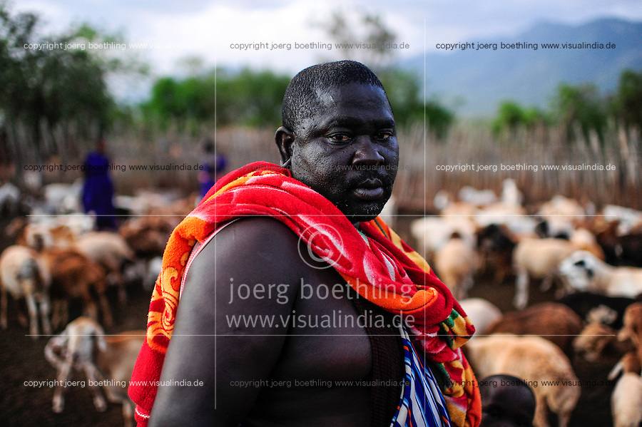 TANZANIA, Korogwe, Massai in Kwalukonge village, massai chief in Kral with goats/ TANSANIA, Korogwe, Massai im Dorf Kwalukonge, Massai chief SOGOLO BATIMAYO LAZARO im Kral mit Ziegen